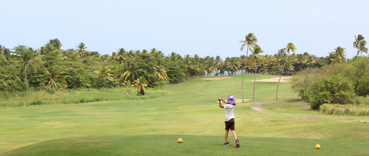 Girl hitting Golf Shot Puerto Rico Picture